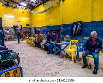 Bogota, Colombia - April 30, 2016: Colombian men are playing tejo game in the local tejo club.Tejo, also known, to a lesser degree, as turmeque, is a traditional throwing sport in Colombia.