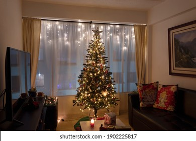 BOGOTA, COLOMBIA - DECEMBER 24 OF 2020 A warm latin american living room in christmas season with soft lights and a candle.