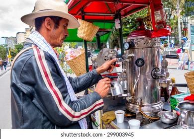 BOGOTA, COLOMBIA - FEBRUARY 25, 2015: Unidentified street vendor selling fresh coffee at Candelaria neighborhood in Bogota Colombia