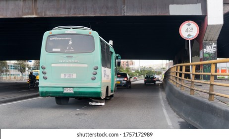 Bogota / Colombia - June 13, 2020: Old, outdated, highly polluting bus driven on 68th street. Bridge tunnel. It is one of the most predominant means of transportation in the Latin, South American city