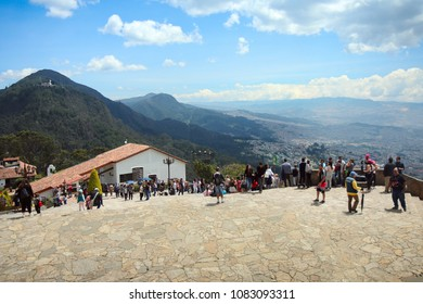 Bogota, Colombia - March 17, 2018: Visitors take in views of Bogota from Mount Monserrate, a popular tourist destination in Bogotá.