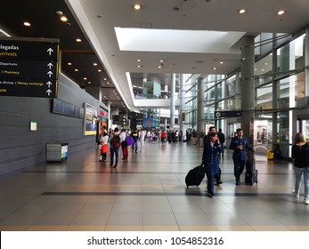 Bogota, Colombia. March 25, 2018. Interior or inside of the airport El Dorado in Bogota. with international tourist and pilot of the plane, signs of departure and arrivals of the flights