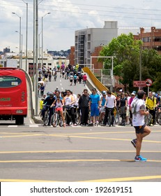 BOGOTA, COLOMBIA - MAY 04, 2014: Pedestrians and cyclists taking part in Ciclovia. Each Sunday and public holiday certain main streets are blocked to cars for runners, skaters, and bicyclists.