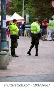 BOGOTA, COLOMBIA - MAY 04, 2014: Two Colombian National Police officers working their post in Bogota Colombia. The Colombian National Police is the largest police force in Colombia.
