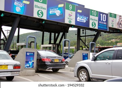 BOGOTA, COLOMBIA - MAY 05, 2014: Toll booth on a major highway in Bogota Colombia. Traffic in Bogota is extreme. There are 832 000 private cars with 70 000 new cars added each year.