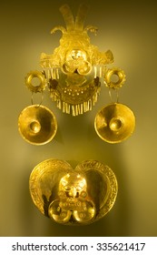 BOGOTA, COLOMBIA, MAY 5: Golden Inca religious objects on neutral color background in gold Museum in Bogota, Colombia 2015