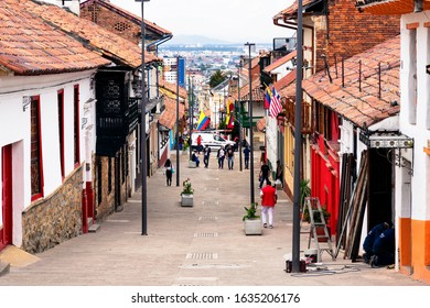 BOGOTA, COLOMBIA - NOV 10, 2019: View of a charming lively colorful street in La Candelaria district in old part of Bogota, Colombia, South America. Small historical townhouses make it wonderful.
