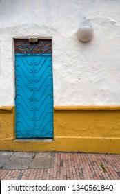 BOGOTA, COLOMBIA - NOV 12:  Home facade in La Candelaria neighborhood of Bogota, Colombia on November 12, 2017.  La Candelaria is popular for its Spanish colonial architecture.