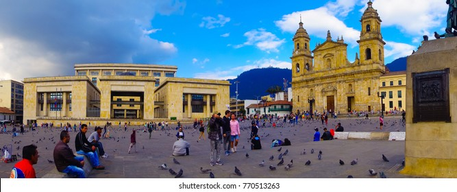 BOGOTA, COLOMBIA OCTOBER 22, 2017: Panoramic view of unidentified people walking and taking pictures in Bolivar square church in a blue sky in Bogota, Colombia, Latin America