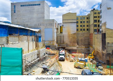 BOGOTA, COLOMBIA OCTOBER 22, 2017: Unidentified people working in a construction area with heavy machinery in Candelaria historic area in downtown Bogota, Colombia