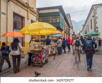 Bogota, Colombia - September 13, 2013: People on the street of Bogota, La Candelaria district