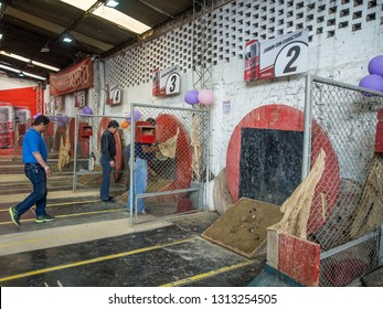Bogota, Colombia - Septemebr. 09, 2017: Colombian men are playing tejo game in the local tejo club.Tejo, also known, to a lesser degree, as turmeque, is a traditional throwing sport in Colombia.