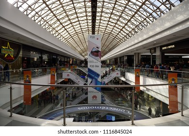 Bogota, Colombia / South America - June 13 2018: Centro Comercial Gran Estacion, Shopping Center Mall, people are riding escalators, walking, shopping and dining under the skylight roof of the mall.