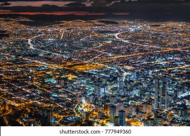 Bogota, Colombia, view of cityscape with downtown buildings illuminated at dusk.