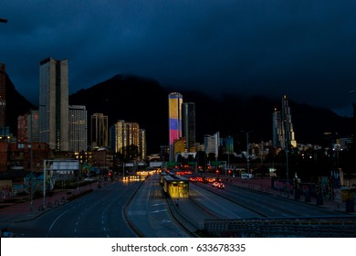 BOGOTA,COLOMBIA-JUNE 26,2016: Cityscape at night time of buildings and streets of Bogota,Colombia. On the Background the Colpatria Tower Building is iluminated with led lights.