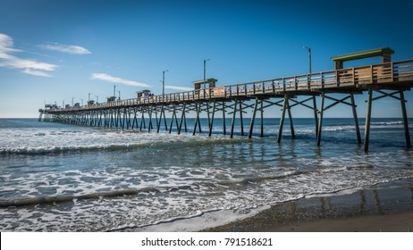 Bogue Inlet pier with blue skies and waves