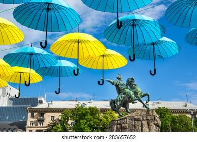 Bohdan Khmelnitskiy monument unde bright umbrellas on Kiev`s day. Kiev, Ukraine.