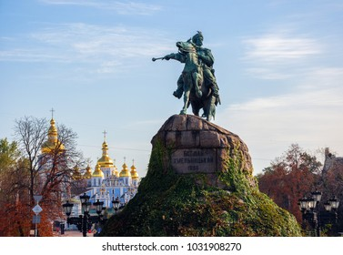 Bohdan Khmelnytskyi monument and St. Michael's Golden-Domed Monastery on background. Location place: Sofia Square, Kyiv, Ukraine. English translation text on the monument: Bohdan Khmelnytskyi.