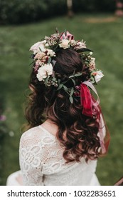 Bohemian bride with long brown hair and flower crown at the wedding
