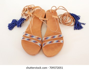 bohemian greek leather sandals in blue and turquoise colors - fashion shoes advertisement