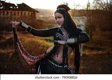 Bohemian Gypsy woman in the sunset dancing