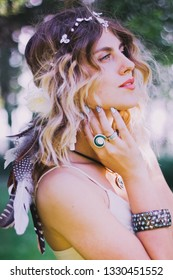Bohemian hippie girl in white dress. Woman hands with lot of boho style jewelry, blue rings,silver bracelets and henna tattoo. Coachella fashion style look, outfit.