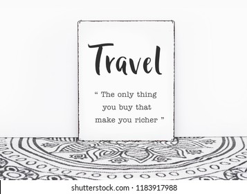 Bohemian vintage carpet travel quote travel is the only thing you buy that makes you ricer text on board white isolated wall background