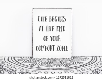 Bohemian vintage carpet travel quote ife begins at the end of your comfort zone text on board white isolated wall background