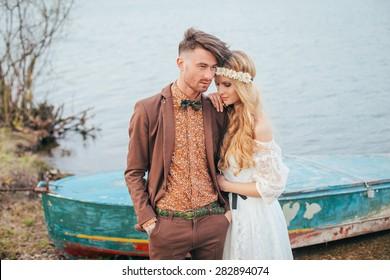 Bohemian wedding on the sea. Stylish and young couple