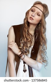 Bohemian woman in spring and summer clothes with beautiful accessories, natural make-up and shiny hairstyle. Fashion hippie style. Long curly hair.
