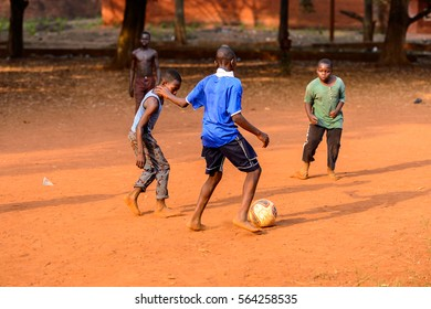 BOHICON, BENIN - JAN 11, 2017: Unidentified Beninese children play football with bare feet. Soccer is very popular game among the  African kids