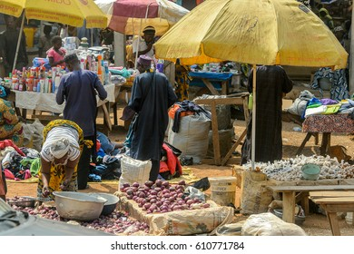 BOHICON, BENIN - JAN 12, 2017: Unidentified Beninese people sell goods at the local market. Benin people suffer of poverty due to the bad economy.