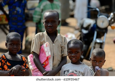 BOHICON, BENIN - JAN 12, 2017: Unidentified Beninese children gather together at the local market. Benin children suffer of poverty due to the bad economy.