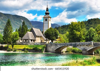 Bohinj Lake, Church of St John the Baptist with bridge. Triglav National Park, Julian Alps, Slovenia.