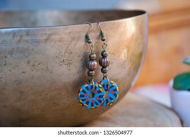 Boho dangling bronze copper earrings. Handmade jewelry of polymer clay.
