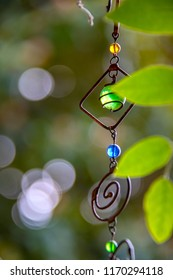 Boho hanging mobile art - wire art -  with bokeh leaves and background