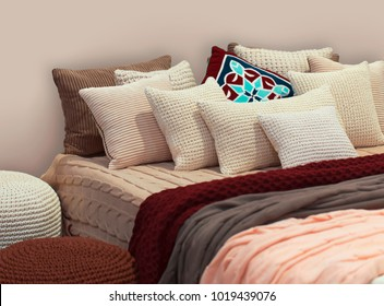 Boho style bedroom with knitted decorations.