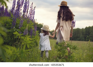 Boho style family during summer vacation in wood glade