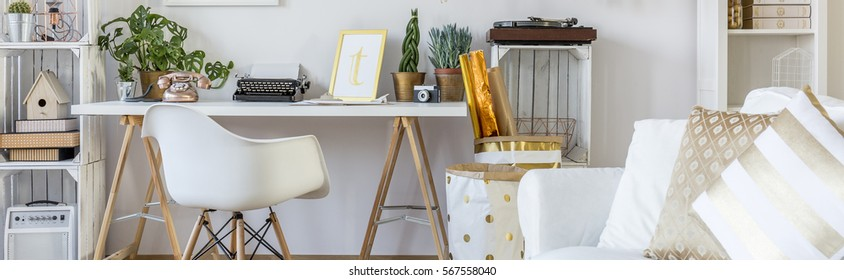 Boho style home workspace with white chair and simple desk