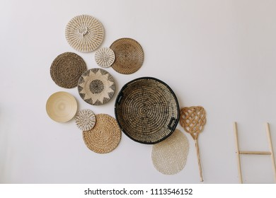 Boho style, minimal home interior design. Decorative straw plates on the wall