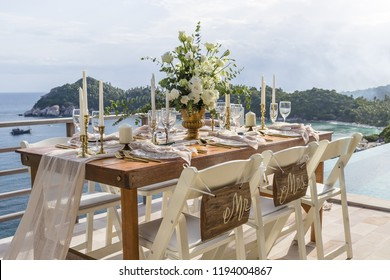 Boho Style Theme Romantic Wedding Table Top Layout Table Spread no people no human tropical location with gold cutlery and scenic view tablescape
