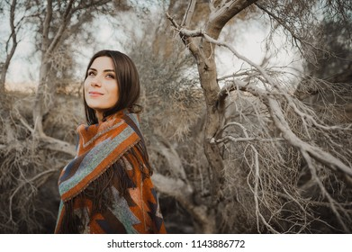 Boho woman, hipster girl in gypsy look, young traveler in the desert nature.
