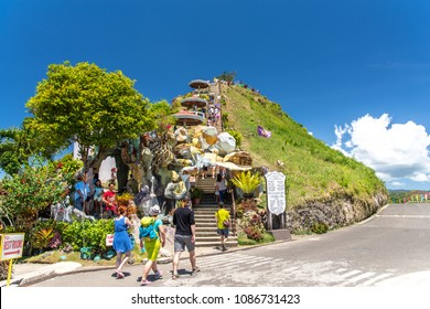 Bohol island, Philippines. Apr 23, 2018 : Tourists climbing on the Chocolate Hill Observatory