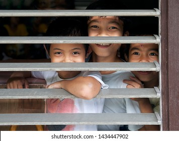Bohol, Philippines, 6 feb,2016: children smiling and looking through the school window straight to the camera.Philippines kids at school. Smiling kids. Happy childhood