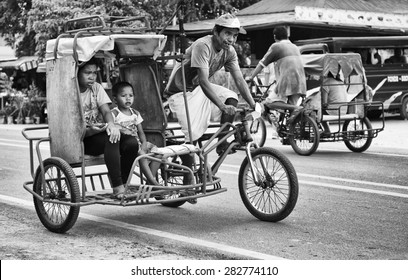 BOHOL, PHILIPPINES - FEB 3: traditional and typical transport in the street of Bohol, Philippines,Feb 3, 2014. Tricycle motor taxi, Philippines inexpensive transport service. Black and white photo