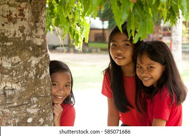 BOHOL, PHILIPPINES - June 23, 2014: Filipino girls smiling at camera under the tree, Bohol island, Philippines