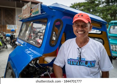 Bohol, Philippines - September 11 2019: A tricycle driver smiling at the camera.