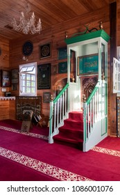 BOHONIKI, POLAND -  MAY 03, 2018: Wooden tatar-mosque interior from the 18th century. The decorations are mostly modern, though original woodwork and panels of 19th century decoration are preserved.