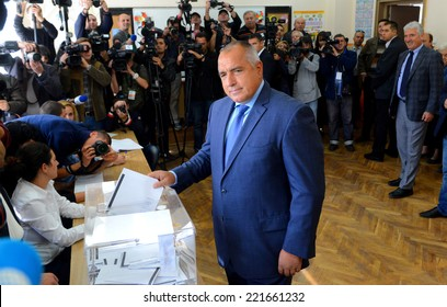 Boiko Borisov, leader of Bulgaria's centre right GERB party, walks out of a polling booth before casting his vote in Sofia October 5, 2014. Bulgaria