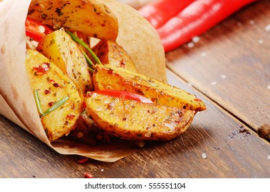 Boiled and baked potatoes with herbs and salt in paper
